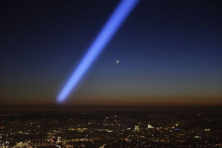 Aerial view of illuminated ferris wheel against sky at night