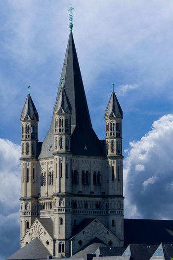Close-up of the the Great Saint Martin Church in Cologne / Germany 2018. Height: 50 meters Style: romanesque architecture Built: in the 10/11st century Architecture Cathedral Catholic Church Cologne Dramatic Sky Historical Building Saint Martin Tourist Attraction  Belief Building Cloud - Sky Europe Germany Gothic Style Historic History No People Old Religion Romanesque Saint Martin Church Spirituality Tower Travel Destinations