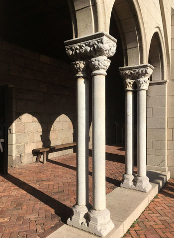 Medieval colonnade from the 12th century BCE. Late afternoon with long shadows. Cloister of a medieval church, warm sunlight and long shadows. Arch Architectural Column Architecture Built Structure Catholic Church Church Architecture Cloister History Monastary No People Outdoors Religious Architecture