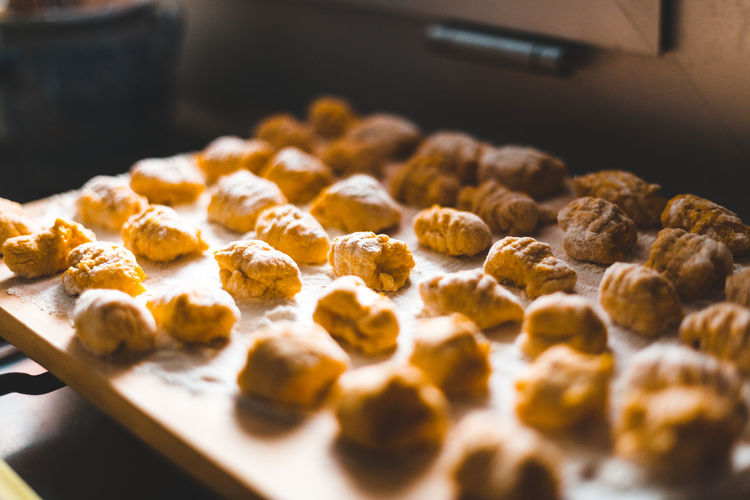 High angle view of gnocchi on table Food And Drink Food Sweet Food Indulgence Freshness Baked Indoors  Sweet Temptation Still Life Close-up No People Preparation  Baking Sheet Tray Snack Selective Focus Preparing Food Domestic Room Kitchen Kitchen Utensil Dessert Dough