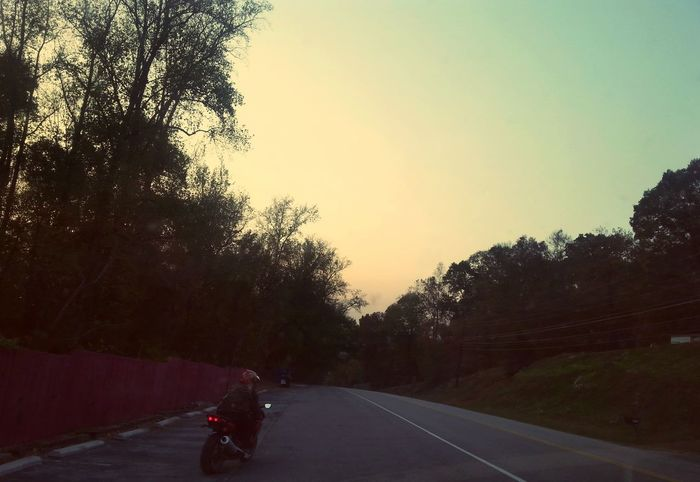 Tree Road Sunset One Person Nature Outdoors Beauty In Nature People Adults Only Only Men Sky Day One Man Only Adult Motorcycle Racing Motorsport AMPt_community Streamzoofamily NEM Submissions Rider Roadtrip Sunrise Rebel Rebel Speed The Drive Long Goodbye Welcome To Black The Secret Spaces