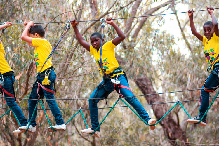 Travel Suspension Bridge Safety Group Of People Sport Leisure Activity Tree Full Length Enjoyment Protection Safety Harness Togetherness Young Adult Lifestyles Young Men Nature Human Arm Rope Males  Limb Outdoors Africa Agadir Morocco Travel African Children This Is Strength