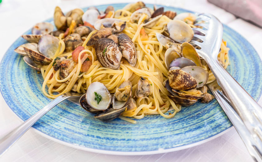 High angle view of spaghetti with clams on plate