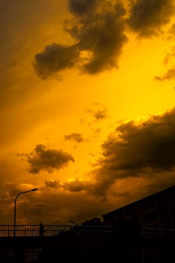 每看日起日黄昏,万里浮云一杆身,往还桥头名利客,来去江湖行路人。 sunset Sunset Cloud - Sky Orange Color Silhouette Low Angle View Street Light Outdoors People Walking