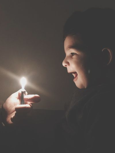 Side view of teenage girl in the dark
