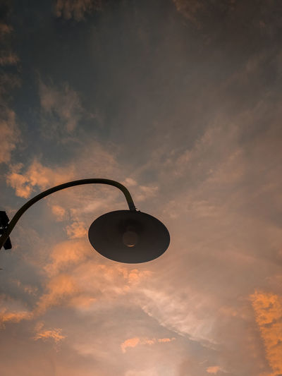 Low angle view of street light against sky at sunset