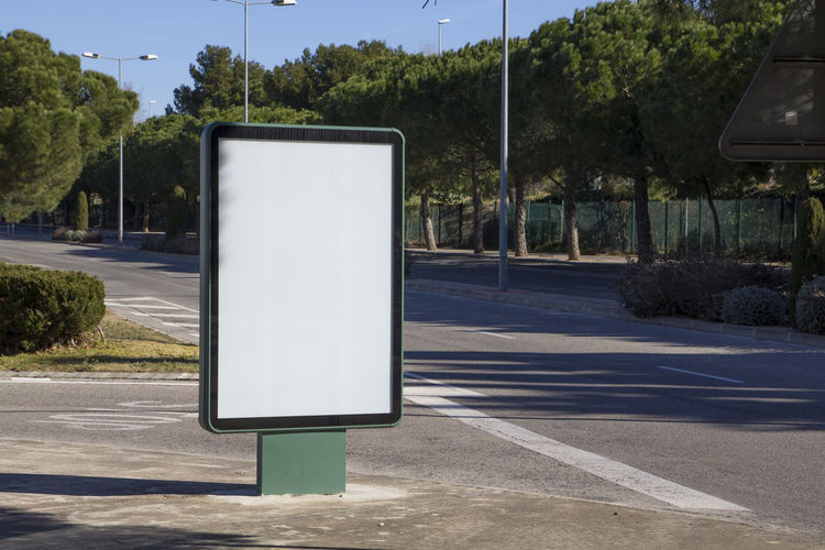 Blank billboard outdoors, in a public zone Billboard Blank Advertising Bus Ad Poster City Sign Street Empty Panel Outdoor Space Banner Board Marketing White Urban Background Media Information Display Travel Advert Advertisement Road Message Commercial Public Frame Tree Pine Park