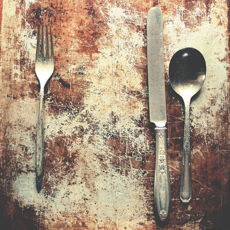 Rustic dining Background Concept Cooking Copy Space Cutlery Dinner Fine Dining Food And Drink Fork Knife Meal Menu Metal Ornate Place Setting Restaurant Rustic Silverware  Spoon Still Life Table Setting Tarnished Top View Variety Vintage