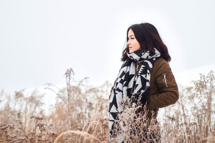 Shooting with Emily One Person Field Leisure Activity Lifestyles Plant Land Real People Nature Standing Sky Young Women Day Young Adult Women Casual Clothing Hairstyle Beauty In Nature Side View Outdoors