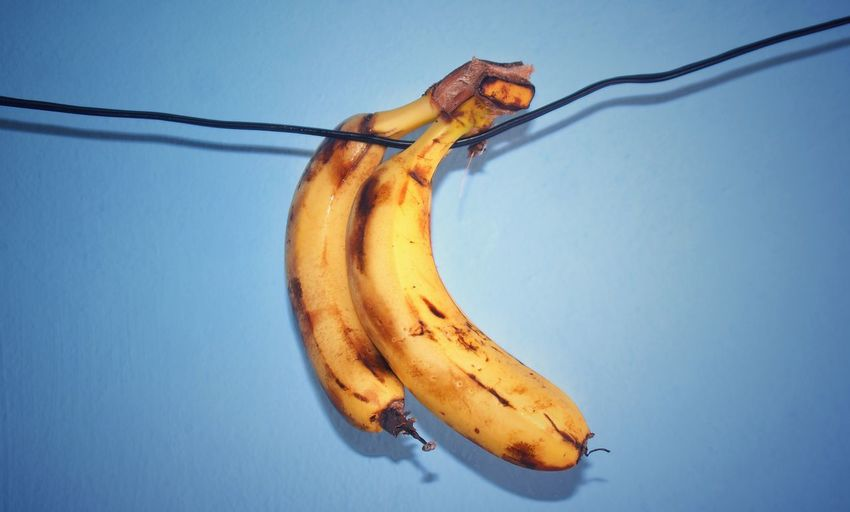 Close-Up Of Banana Against Blue Background