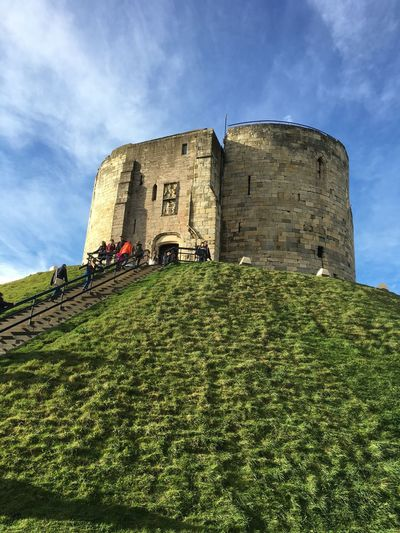 Clifford's Tower in York Blue Sky Hill Mound 13th Century Keep Cliffords Tower, York Architecture Sky Built Structure History The Past Building Exterior Ancient Nature No People Medieval Plant Green Color Castle Low Angle View Cloud - Sky Grass Day Fort Building Old