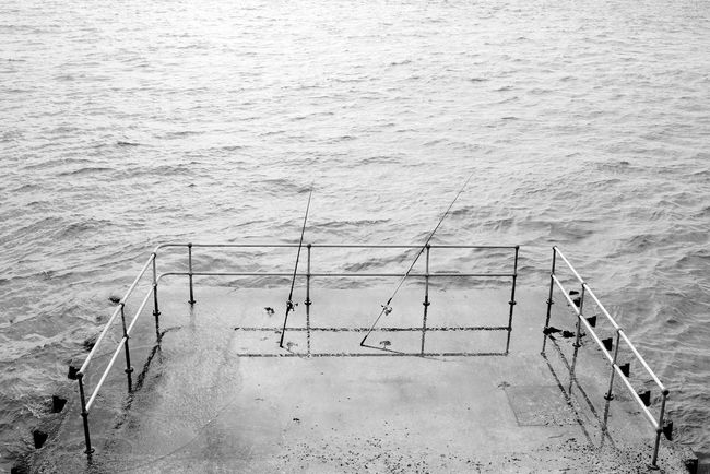 Gone Fishing Architecture Blackandwhite Day High Angle View Hotwalls Outdoors Railing Rippled Sea Tranquil Scene Tranquility Water