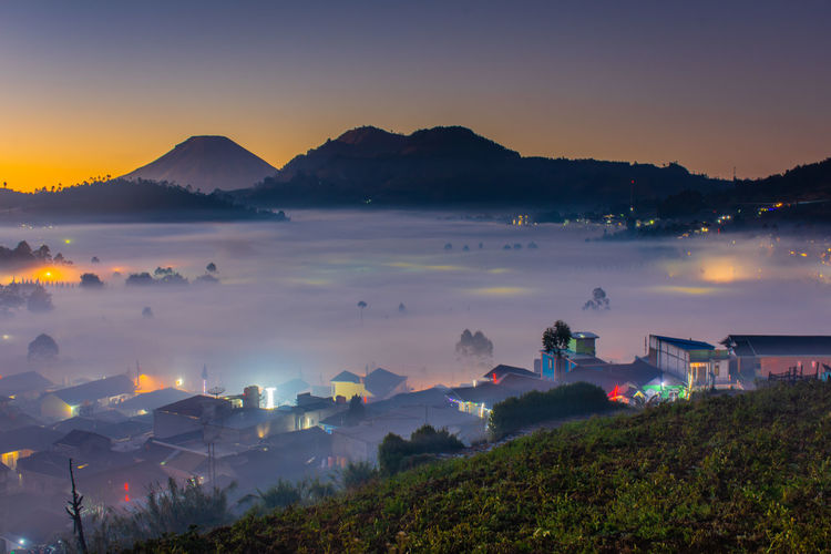 Village view covered with clouds in the morning at dieng palteau, central java, indonesia