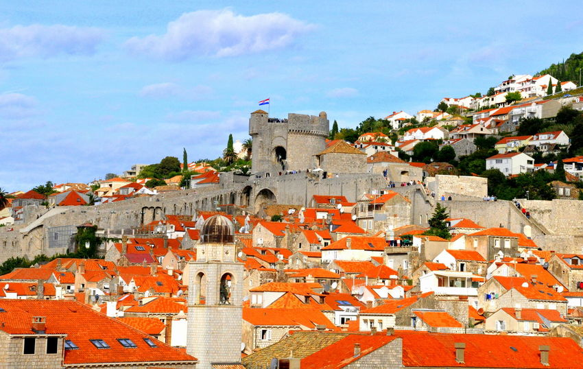 The view of the town and red roof from the top of the Wall of Dubrovnik in Croatia City Dubrovnik, Croatia Wall Architecture Building Building Exterior Built Structure City Cityscape History Outdoors Residential District Roof Sky Town TOWNSCAPE Travel Travel Destinations