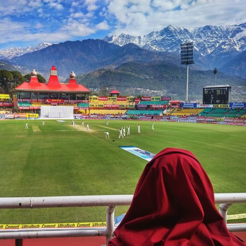 Test match with a view! Dharamshala is one of the most scenic places to enjoy cricket! Capital of the tibetan govt in exile, it is not uncommon to see monks here at the stadium. Travel Sport Cricket! Cricket Match Testcricket IndvsAus Stadium Mountains Monks Monk  Tibetan Buddhism Tibet Travel Dharamsala McLeod Ganj DharamshalaDiaries Dharamshala HPCA BCCI ICC Aussie Himachal Triund