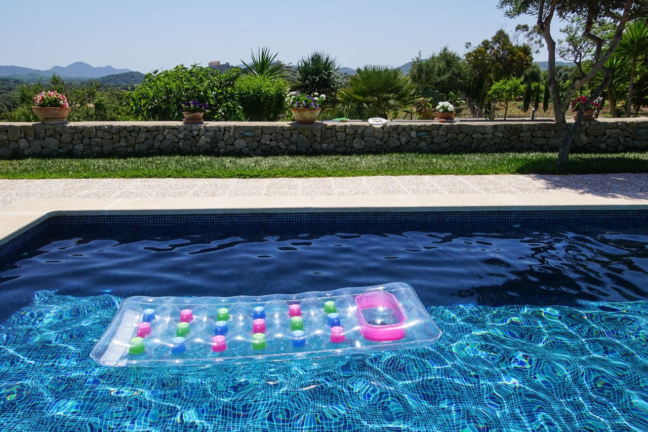 Pool Raft Floating In Swimming Pool