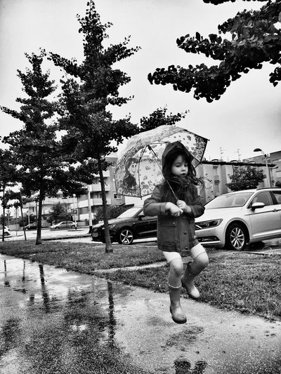 Dance in the rain...💦☔️ Happy Child  Jumping Puddle Splash Puddle Rainy Days Rain One Person Tree Full Length Childhood Plant Child Nature Real People Girls Day Sky Outdoors