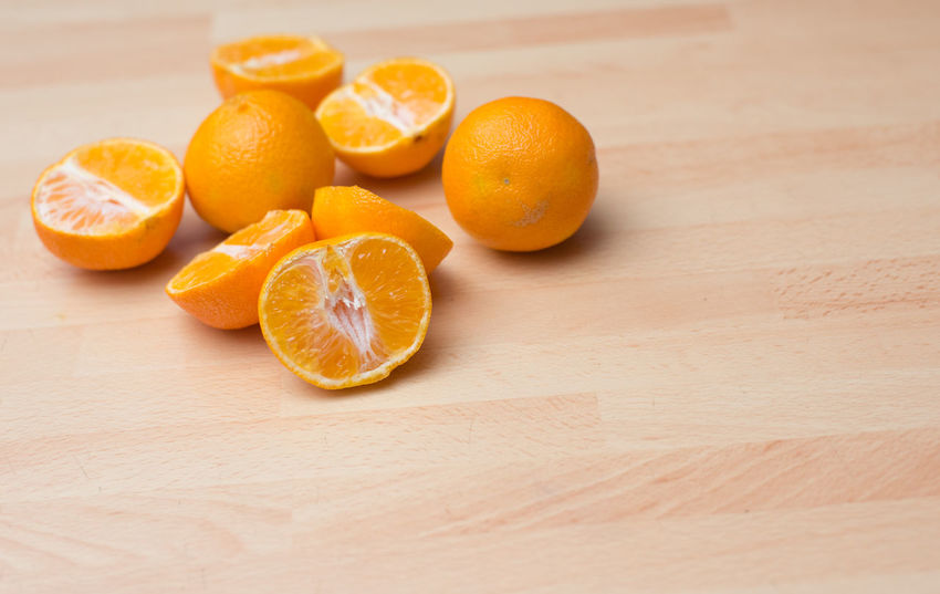 Citrus Fruit Close-up Cross Section Food Food And Drink Freshness Fruit Grapefruit Halved Healthy Eating Indoors  Juicy No People Orange - Fruit SLICE Sour Taste Table Tangerine Whole