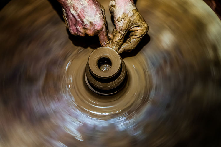 Hand Human Hand Spinning One Person Human Body Part Pottery Motion Real People Craft Art And Craft Clay Skill  Creativity Working Indoors  Human Finger Blurred Motion Finger Holding Mud