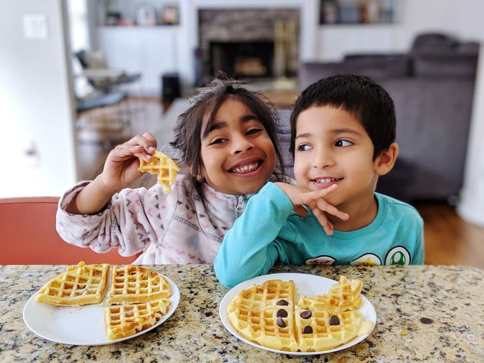 happiness is food and togetherness Kidsphotography Kids Kids Being Kids Sibling Love Siblings ♡ Waffles!! Waffle Waffle Time Chocolate Moments Of Happiness Child Eating Portrait Togetherness Smiling Childhood Looking At Camera Plate Happiness Girls