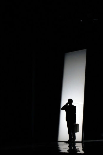 An actor in the stage during an opera show Alone Communication Copy Space Curtain Dark Hobbies Home Interior Indoors  Light Music Occupation One Person Paper Silhouette Single Object Studio Shot Text Togetherness Wall Wall - Building Feature White White Background