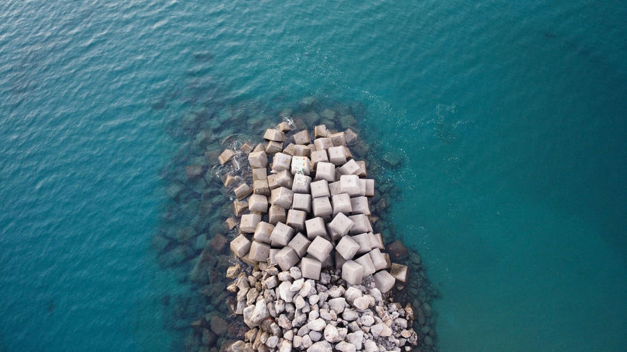 High angle view of stones on sea shore
