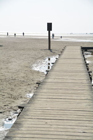 Beach Beauty In Nature Boardwalk Calm Day Diminishing Perspective Horizon Over Water Idyllic Jetty Nature Non-urban Scene Ocean Outdoors Pier Scenics Sea Shore Sky The Way Forward Tranquil Scene Tranquility Water Wood Wood - Material Wooden