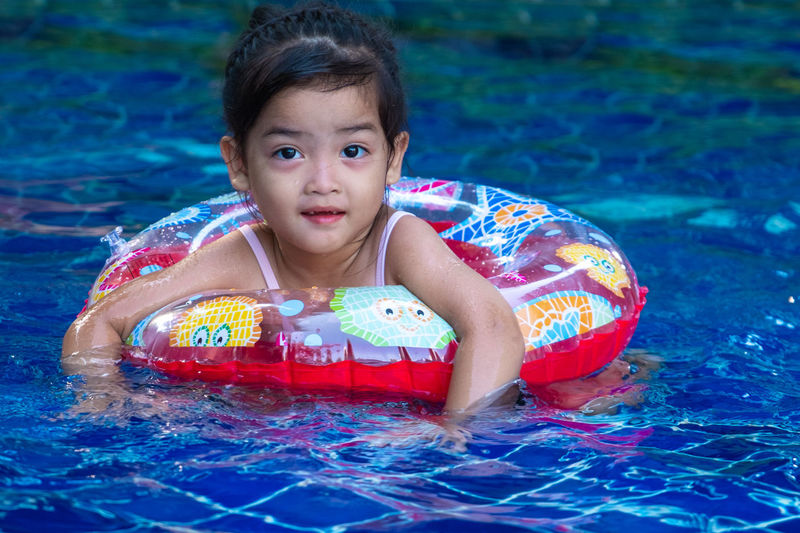 Portrait of cute little asian girl having fun in swimming pool, floating in blue refreshing water with colurful rubber ring Girl Kid Swimming Pool Life Ring Water Child Fun Play Young Outdoor Cute Happy Joy Enjoy Relax Float Blue Summer Vacation Lifestyle Swim Holiday Wet Childhood Activity Fresh Leisure Healthy Refreshing Caucasian Sunlight Little Rubber Sun Happiness Sport Relaxation Smiling Nature Beauty Family Asian  Aqua Funny Floating Liquid Playful Smile The Portraitist - 2019 EyeEm Awards