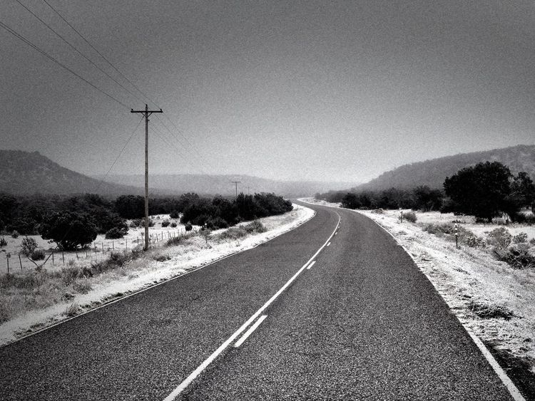 """""""Into The Fog"""" Rural Route 42 in Central New Mexico on a snowy and foggy morning heading to the tiny Village of Corona, NM October 15, 2018. New Mexico New Mexico Photography Blackandwhite Black And White Photography Snow Foggy Morning Foggy Fog Rural Roads Rural Highway Road The Way Forward No People Diminishing Perspective vanishing point Landscape"""