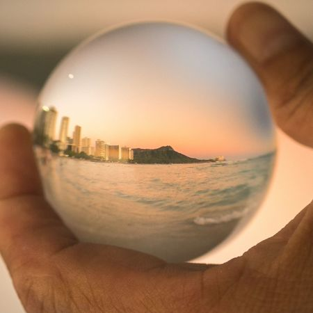 Waikiki Beach in a crystal ball. Crystal Ball Hawaii Waikiki Waikiki Beach Close-up Crystal Ball Day Diamond Head Focus On Foreground Glass - Material Hand Hawaiilife Holding Human Body Part Human Hand Indoors  Nature One Person Reflection Sky Sphere Table Transparent Upside Down