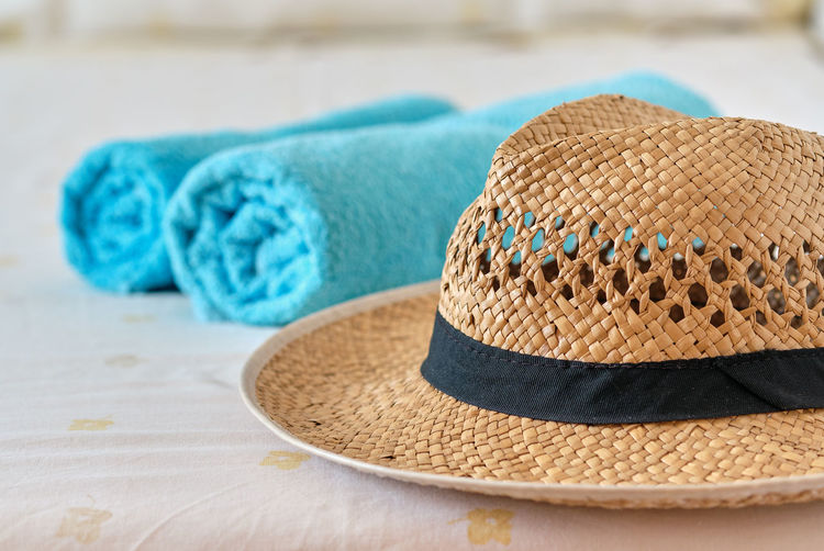 Folded No People Nobody Accessories Background Bathing Beach Beachwear Blue Bright Brown Casual Closeup Collection Concept Fashion Feminine  Girly Hat Holiday Items Journey Leisure Lifestyle Object Recreational  Relax Relaxation Resort Season  Straw Summer Summertime Sunhat Table Tourism Towel Travel Traveler Vacation Weekend Wicker Close-up Sun Hat Indoors  Straw Hat Focus On Foreground Protection Selective Focus Personal Accessory