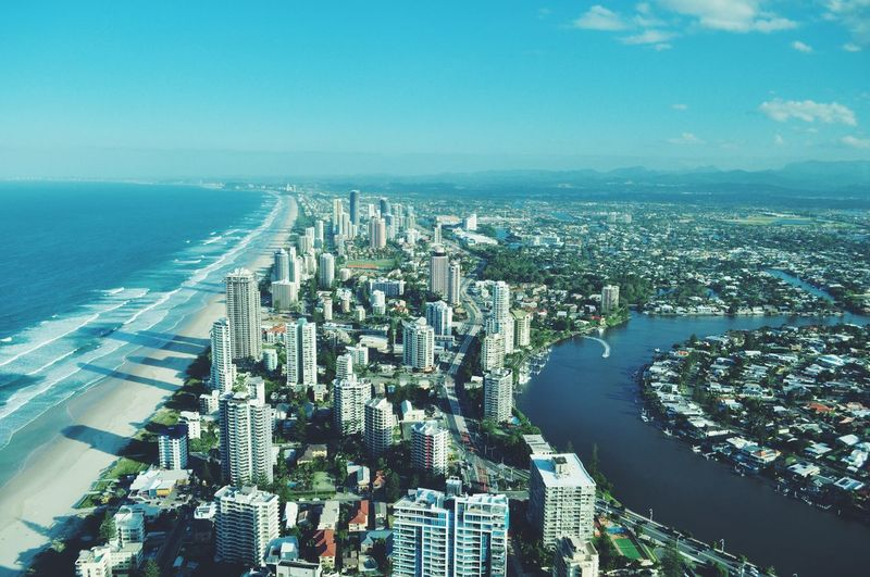 Aerial View Architecture Blue Built Structure Capital Cities  City City Life Cityscape Coastline Financial District  Horizon Over Water Modern No People Office Building Outdoors Residential Building Residential District Sea Sky Skyscraper Tall - High Tourism Travel Destinations Urban Skyline Water