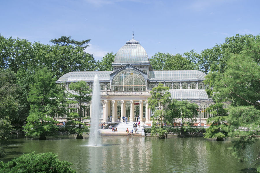 Architectural Column Architecture Building Exterior Built Structure Crystal Palace Day Fountain Glass Palace Growth Lake Madrid Spain Nature Nature Outdoors Palacio De Cristal Park Parque Del Retiro Plant Real People Sky SPAIN Travel Destinations Tree Trees Water