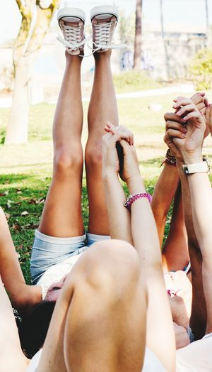 Low section of friends relaxing outdoors