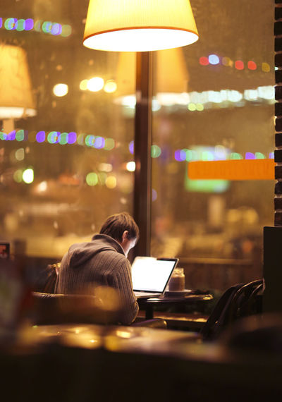 People sitting in illuminated restaurant