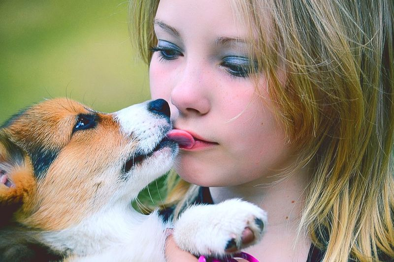 Close-up of girl with dog