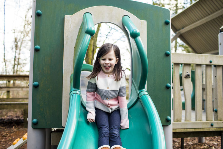 Portrait of smiling girl in playground