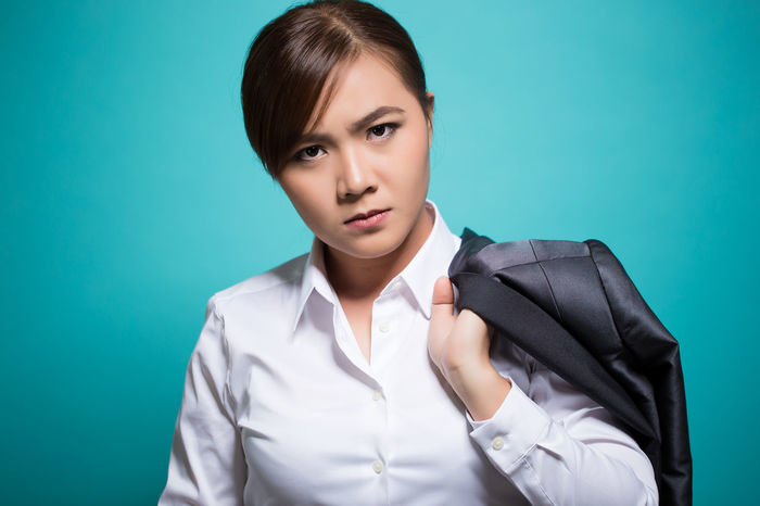 Earnest businesswoman on isolated background Angry Business Copy Space Negative Solemn Suit Thinking Woman Aggressive Blue Background Earnest Emotion Emotional Emotional Stress Fustration Negative Emotion Problem Sad Sad & Lonely Sadness Serious Trouble Vehemently
