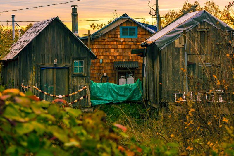 Houses On Field Against Buildings