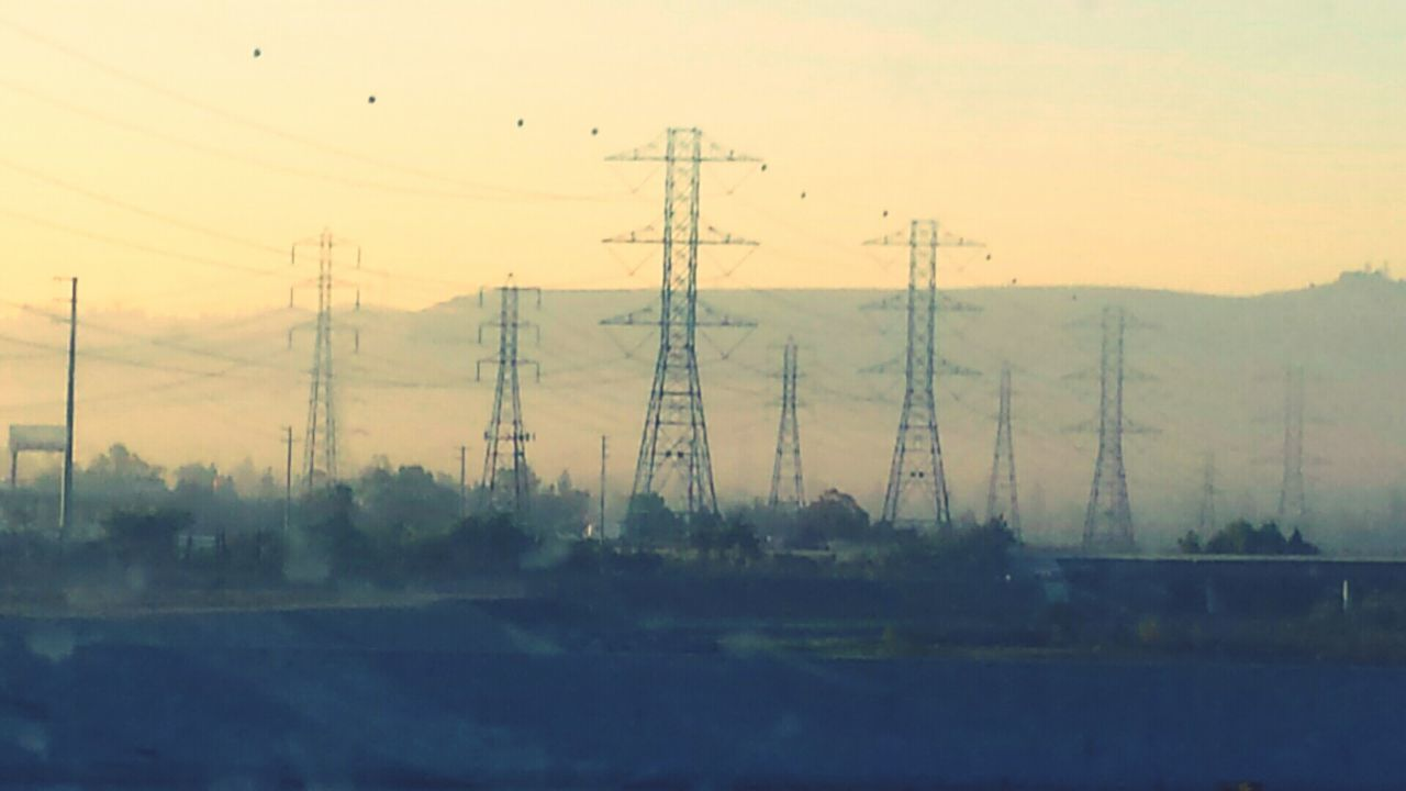 electricity pylon, nature, power line, no people, cable, tree, landscape, tranquil scene, power supply, electricity, beauty in nature, tranquility, outdoors, sky, sunset, telephone line, day