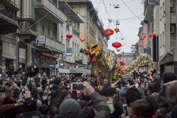Chinese New Year 2018 Adult Celebration Chinatown Milan City Crowd Day Hanging Lantern Large Group Of People Outdoors People Street Togetherness Traditional Festival Women