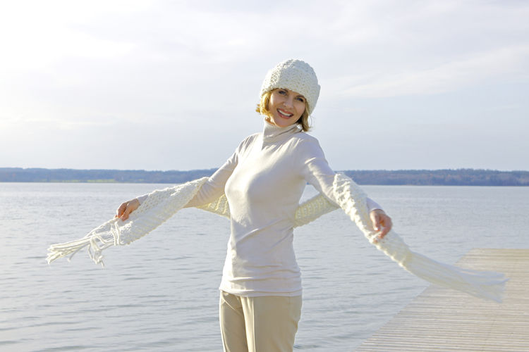 Blonde middle-aged woman on an autumn walk at the lake, portrait Autumn Walk Adult Casual Clothing Cheerful Day Happiness Horizon Over Water Lake Lakeside Leisure Leisure Activity Lifestyles Looking At Camera Middle Aged Nature One Person Only Women Outdoors People Portrait Smiling Water Women Young Women
