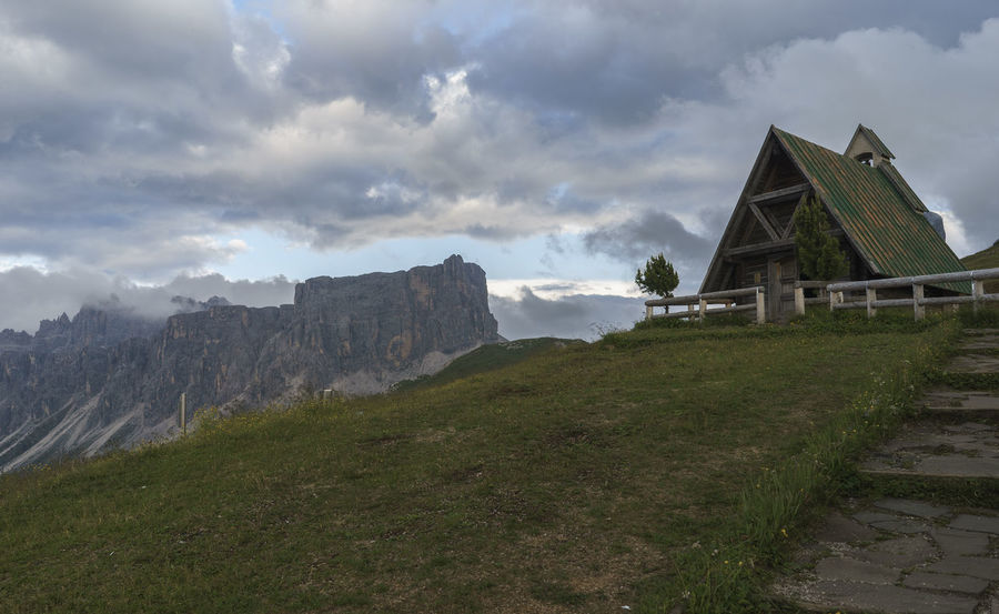 Church Architecture Building Exterior Day Grass Nature No People Outdoors Religion Religious Architecture Sky Alps Colle Santa Lucia San Vito Di Cadore Travel Destinations Mountain Peak Mountain Range Mountain Italy Clouds Passo Giau Valley Dolomites Landscape Panoramic
