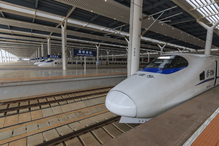 Kunming, China - March 29, 2017: Close up of a Chinese fast train inside the newly opened high speed train station in Kunming. The new fast train station links Kunming to Beijing, Shanghai and Guangzhou Aerospace Industry ASIA Beijing Bullet Train Business Finance And Industry China Cockpit Day Fast Train Gaotie Guangzhou High Speed Train Indoors  Kunming,Yunnan,China No People Passenger Boarding Bridge Shanghai Shinkansen Technology Train Station Transportation Yunnan