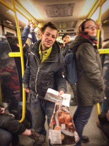 Homeless newspaper salesman. Rush hour, Neukölln. Neoliberalism Germany Poverty Berlin Photography Berlin Subway Train Public Transportation Train - Vehicle Commuter City Life Men Young Men First Eyeem Photo The Graphic City