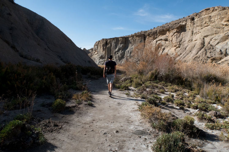 Rear View Of Man Walking At Tabernas Desert