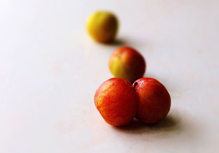 Close-up of plums on table