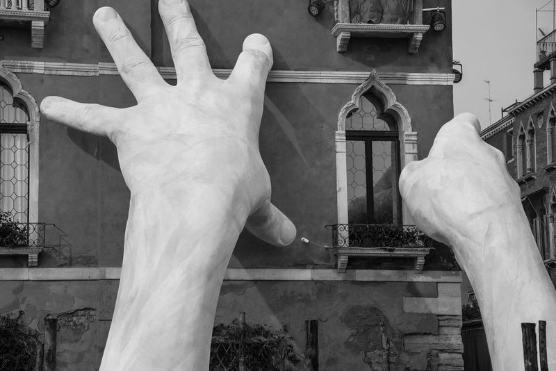 Lorenzo Quinn's new unveiled during Venice Biennale 2017 - Ca' Sagredo Hotel Human Hand Sculpture Art And Craft Human Body Part Built Structure Architecture Building Exterior Close-up Lorenzoquinn  Blackandwhite Art Urban Art Streetphotography Streetart Biennale Venice Italy Cityscape Culture Climate Change Global Warming Travel Destinations Travel Photography