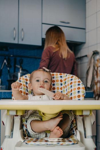 Baby feeding. best finger foods for toddler babies. toddler baby girl with crispbread,