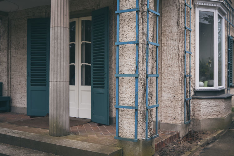 too old and too cold. Architecture Blue Cyan Green Grün Blau Türkis Building Exterior Built Structure Day Door House No People Open Door Outdoors Window